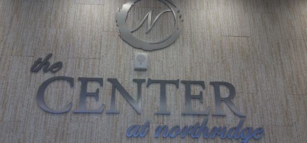 """New ¼"""" brushed aluminum logo and name installed onto tile wall"""